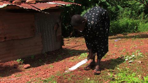 Deaf girl weeding with a machete Footage