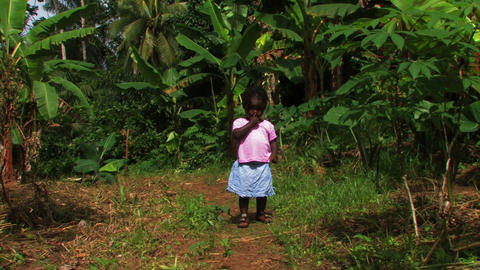 Little African girl walking up a path towards the camera Footage