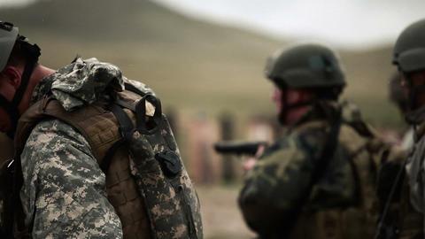 Soldier getting Beretta pistol ready Footage