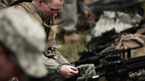 Assault rifle being loaded by soldiers Footage
