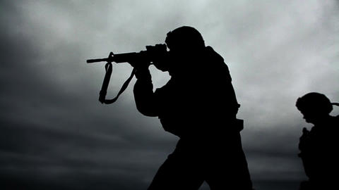Soldier's silhouette at shooting range Footage