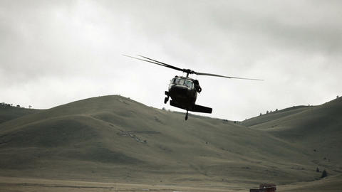 Black Hawk helicopter turning in to land Footage