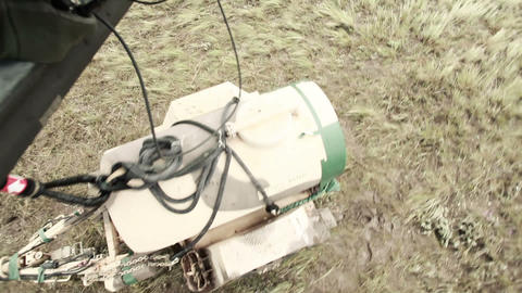 Shot from in Black Hawk helicopter of Soldiers rigging the hauling gear to pick  Footage