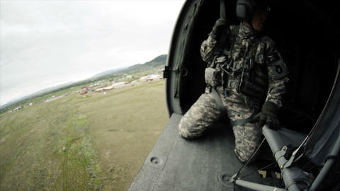 Wide angle shot from in Black Hawk helicopter flying and soldiers in the helicop Footage