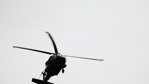 Shot of Black Hawk helicopter flying overhead Footage