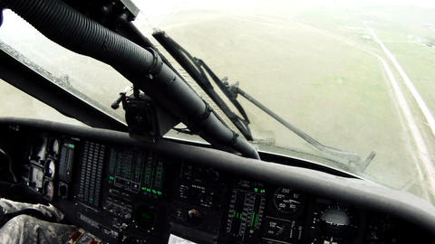Point of view from Black Hawk copilot flying w/ windshield wipers looking around Live Action