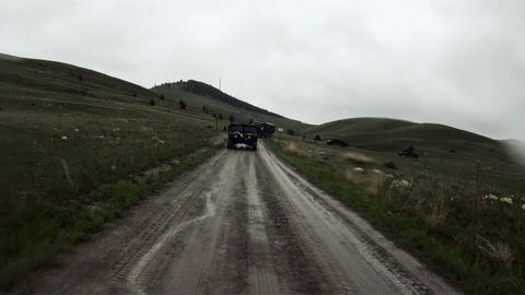Back of a convoy vehicle while driving a dirt road Footage