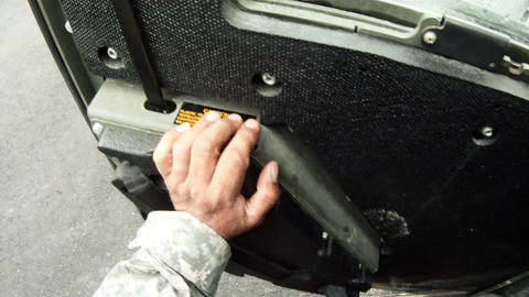 Shot from the driver seat of a Humvee parking and getting out Footage