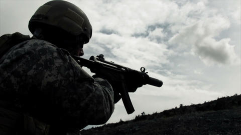 Static shot of soldier shooting automatic rifle Footage