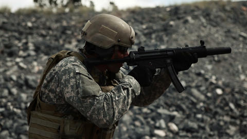Handheld shot of soldier shooting automatic small target rifle at range Footage