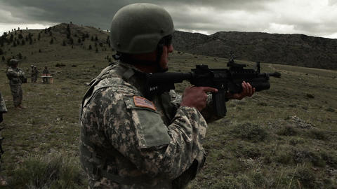 Soldier preparing to fire 40 mm grenade launcher Live Action