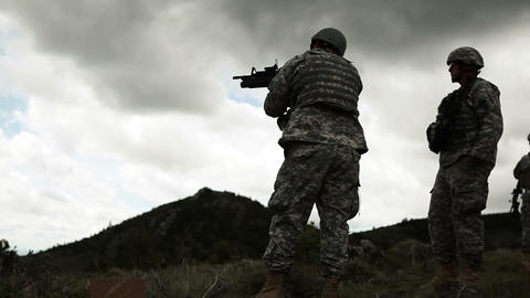 Soldier firing 40 mm grenade launcher attached to M4 assault rifle Footage