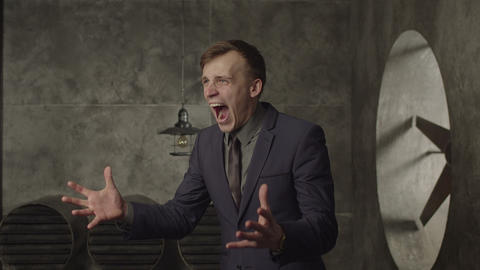 Angry businessman screaming loud in despair Live Action