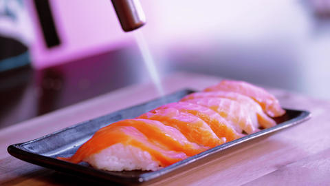 Perparing grilled Salmon Sushi with a hot flame Live Action