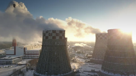 bird eye flight cooling towers with steam clouds at sunrise Footage