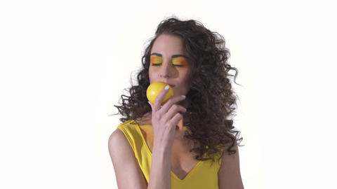 Portrait of young beautiful curly girl sniffing with pleasure fragrant fresh Live Action