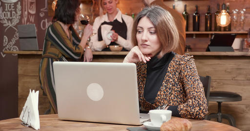 Woman reading very careful and focused an important message at her laptop Live Action