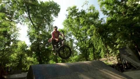 Cyclist in the woods. Riding and jumping over obstacles. The Boy Is Riding In Footage