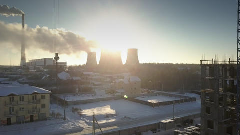 upper view sun rays break through cooling towers and steam Footage