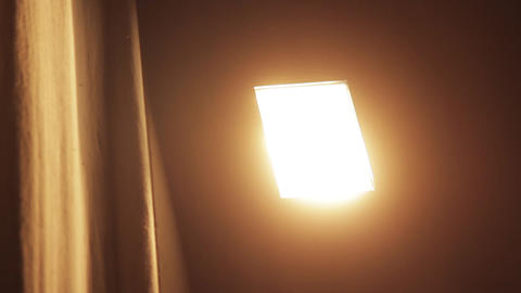 Close-Up Of A Light Bulb In A Cinema Turned On Footage