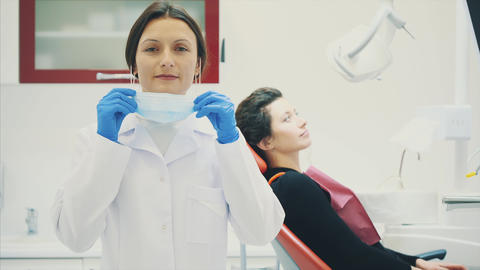 A good specialist. Portrait of a beautiful young woman dentist in a dressing Live Action