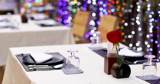Served table with red rose in vase Footage