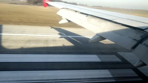 The shadow of landing aircraft moves on the ground until finally landing Live Action