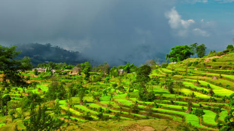 Panning shot of Time-lapse of a terraced, cultivated hillside in Nepal Footage