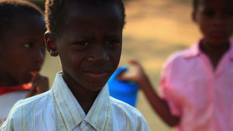 Little Kenyan boy looking at the camera Footage