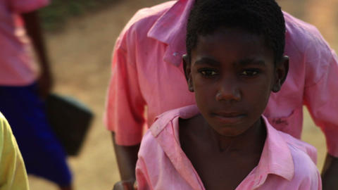 Kenyan girl and boy with a frown and smile Footage