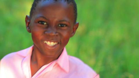 Little jumpy Kenyan boy smiling Footage