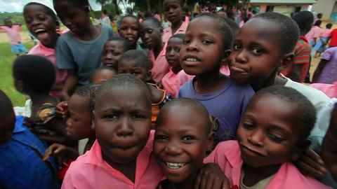 Kids swarm around the camera in Africa part 2 Footage