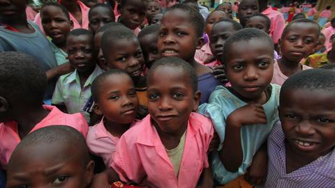 Kids swarm around the camera in Africa part 3 Footage