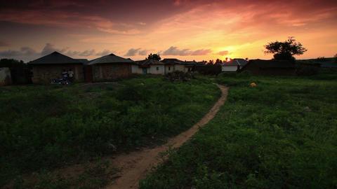 Huts at sunset in Kenya Footage