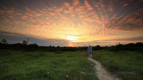 Man at sunrise near a village in Kenya Footage