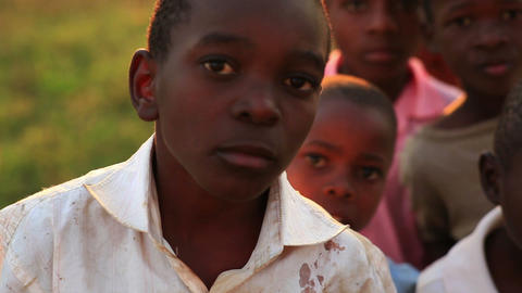 Boys looking at the camera in Africa Footage