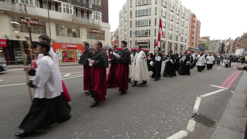 LONDON - OCTOBER 8: Parade of christian priests walk down the street on October  Footage