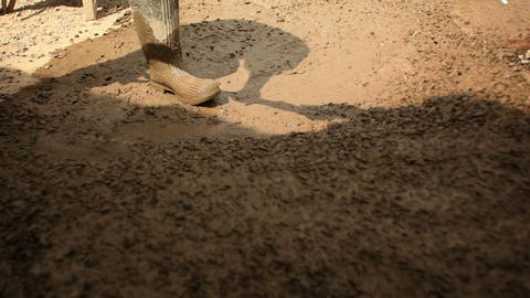 Stirring and moving muddy gravel Footage