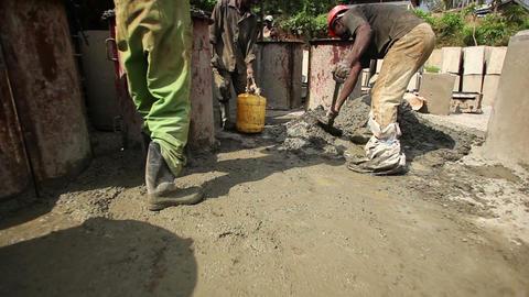 Men shoveling gravel aggressively Live Action