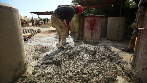 Man shoveling gravel at construction site Live Action