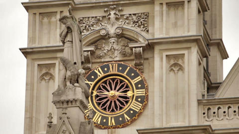 Tower clock of Westminster Abbey with St. George column in foreground Footage
