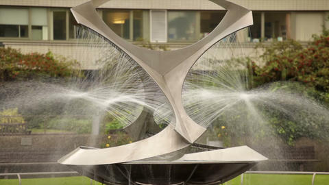 Stationary view of the Revolving Torsion fountain in St. Thomas' Hospital courty Footage