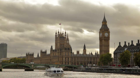 Dark storm clouds behind Big Ben and Westminster palace, Thames river, flying bi Footage