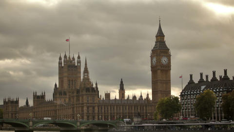 Westminster palace from across Thames River with dark storm clouds in background Footage