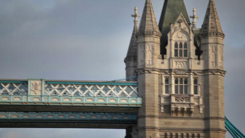 Top of right tower on Tower Bridge with dark clouds in background Live Action