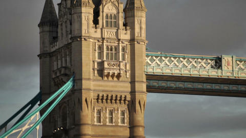 Dark clouds behind the top of the left tower on Tower Bridge in London, England Live Action
