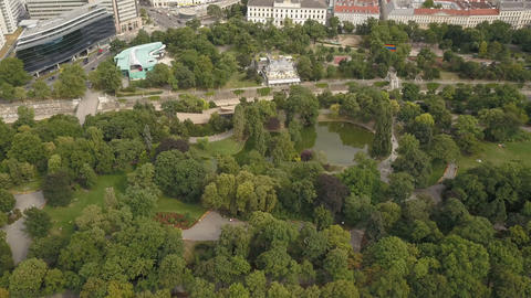 AERIAL View of green park with pond in the center of the city of Vienna, Austria Footage