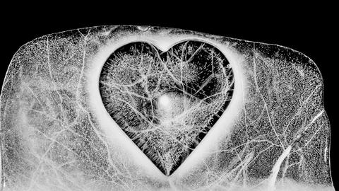 Cracking clear ice heart melting, with alpha Live Action
