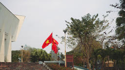 Vietnam flag in front of HANOI. Vietnam flag flying on a flag pole Footage