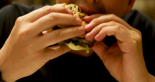 Closeup of man with burger Footage